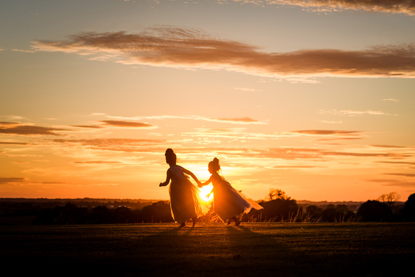 Flower Girls Running Sunset Wedding