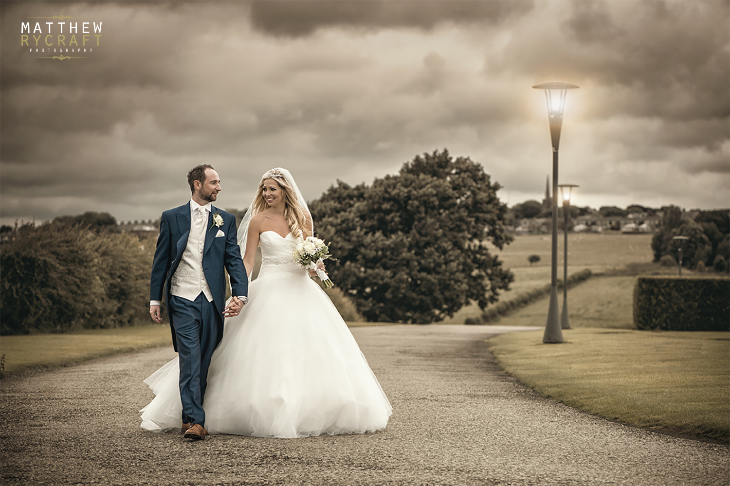 Bride and groom walking holding hands copy