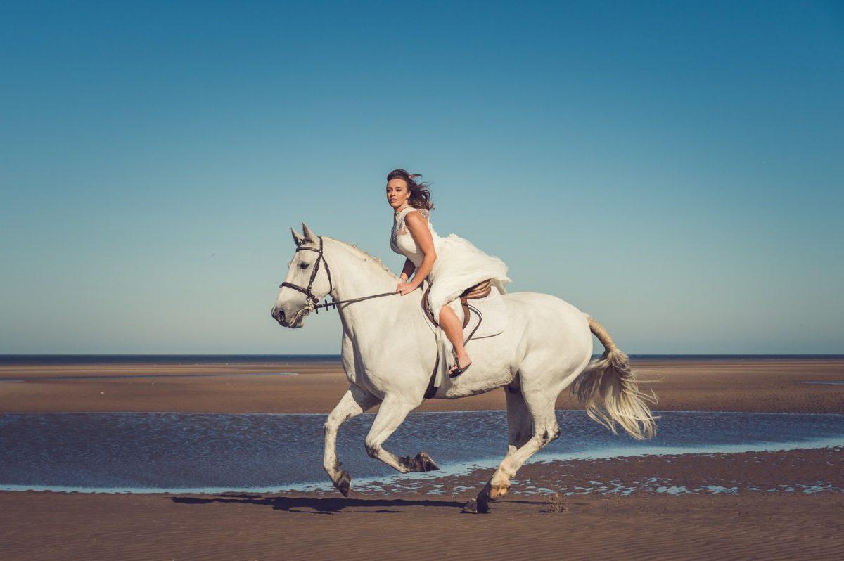 Liverpool wedding photographer Bride Riding Horse Merseyside Beach