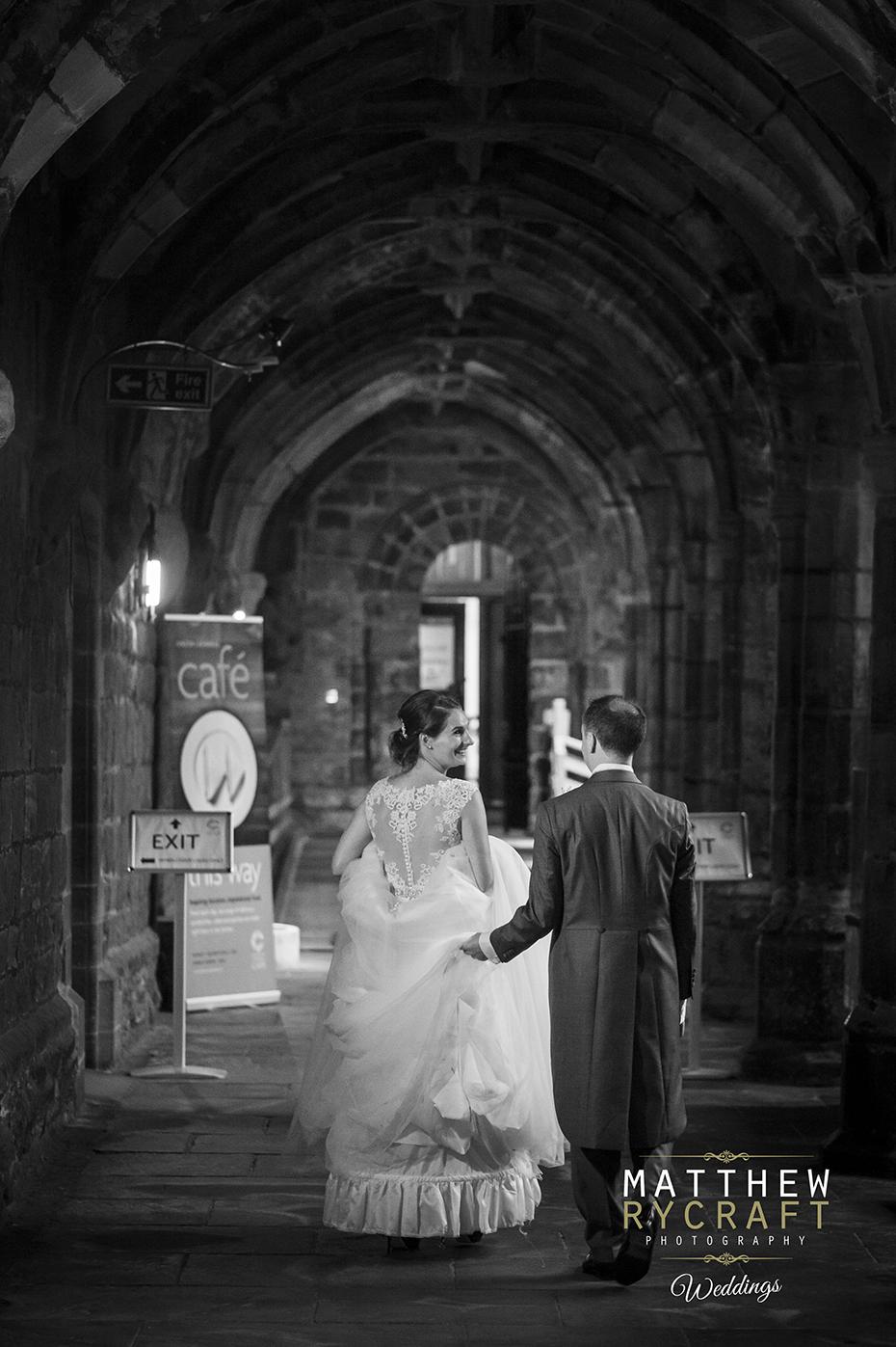 Bride Walking Groom Holding Dress