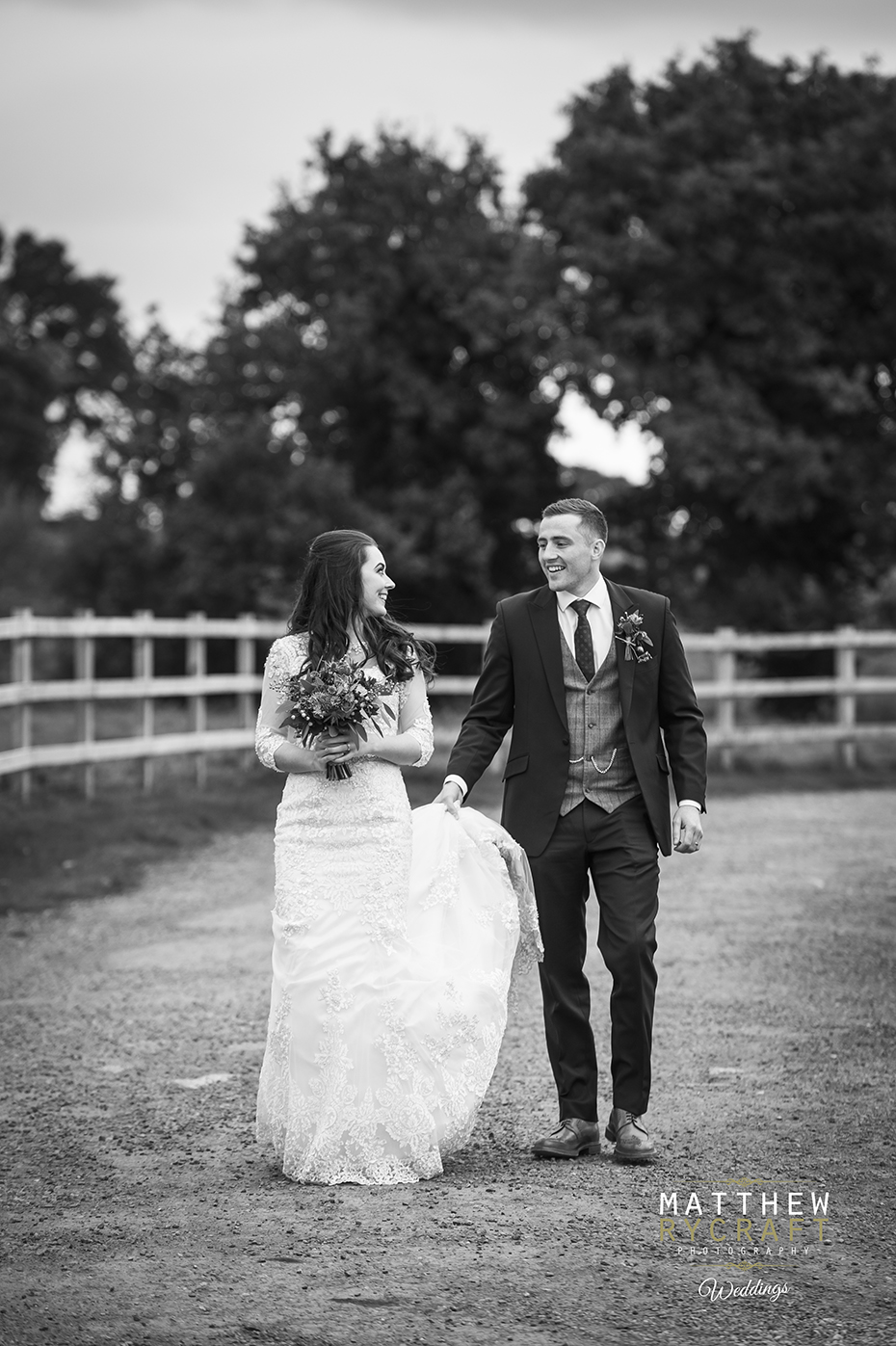 Bride and Groom Walking Wedding Photograph