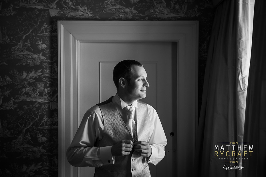 Groom getting ready morning wedding